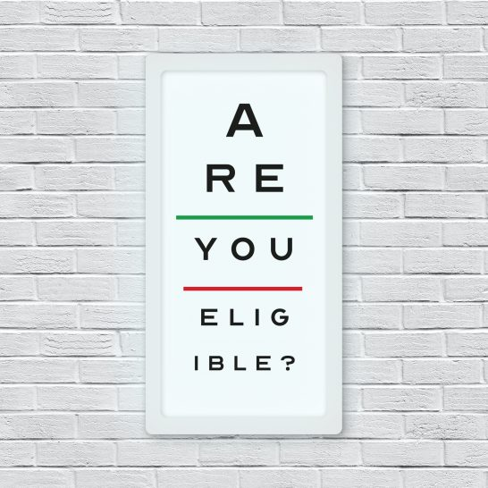 "An image of an eye test on a wall which reads ""are you eligible?"""
