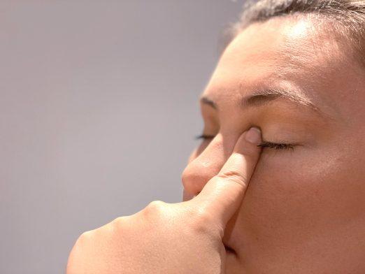 person holding eye shut