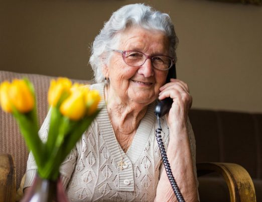 Smiling older lady on phone