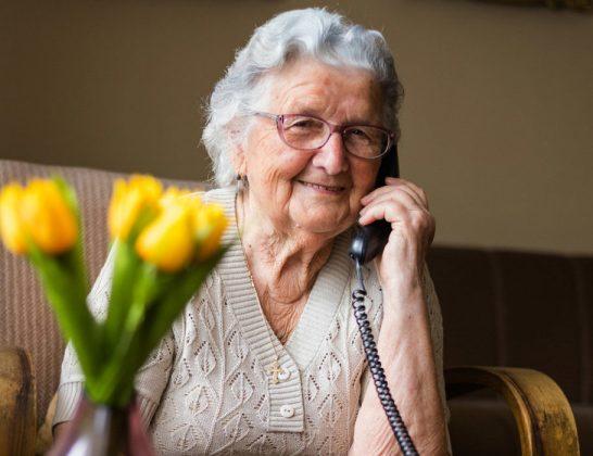 Smiling older lady on phone