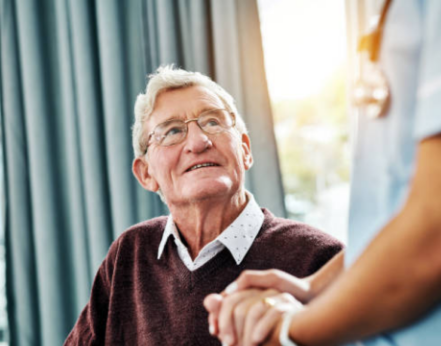 older man looking at a doctor