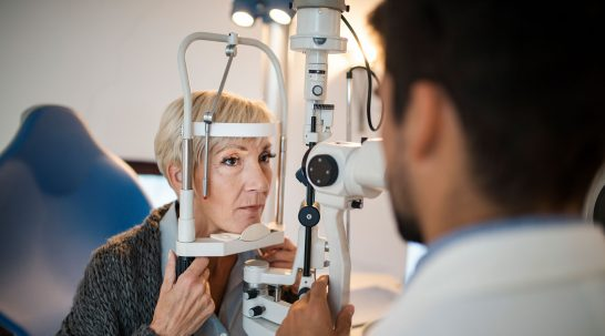 Woman having eyes tested