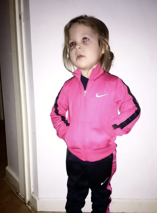 young child in tracksuit
