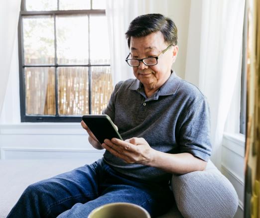 Man looking at phone at home