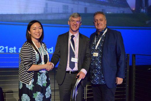 UKEGS research grant winner shakes hand with UKEGS president
